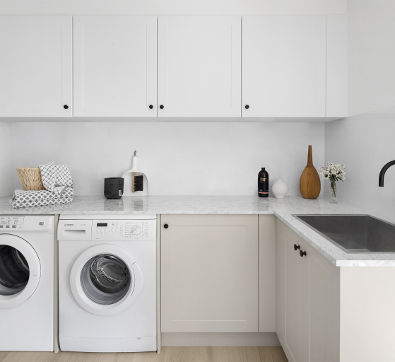 Clean white laundry with washing maching and dryer