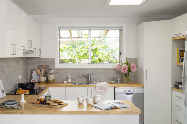 white kitchen with timber benchtop