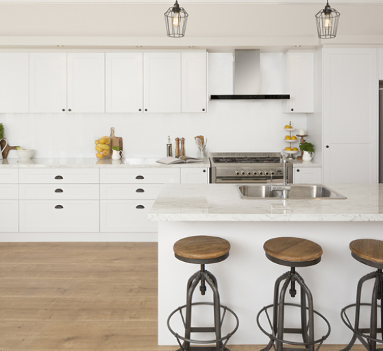 large open white kitchen with island and stools