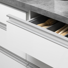 G-pull open drawer achieving the handle-less look