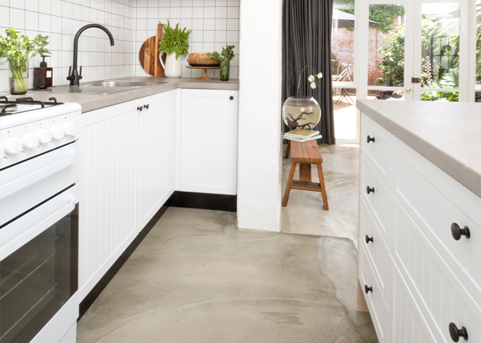white galley kitchen with black cup handles