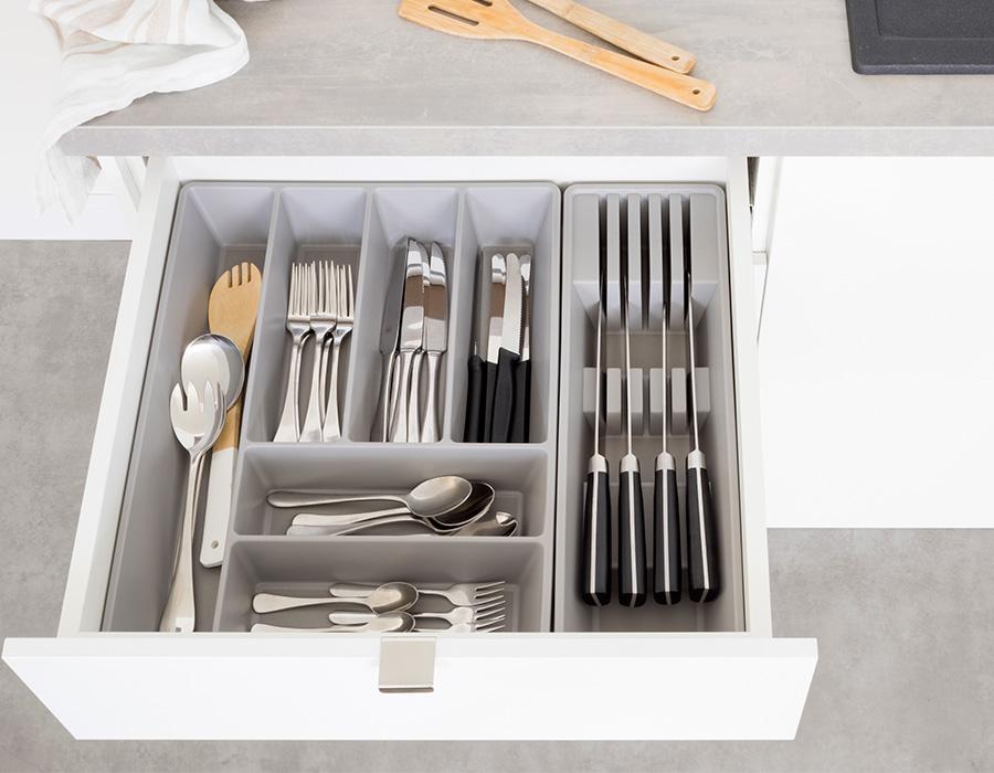 cuttlery draw insert full of utensils