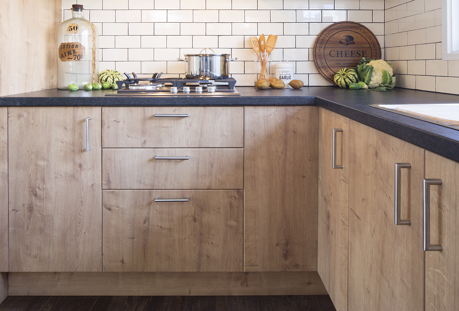 Spiced Oak Doors And Panels With Black Toffee Benchtops
